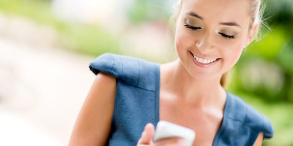 Woman using cell phone., science & tech, money
