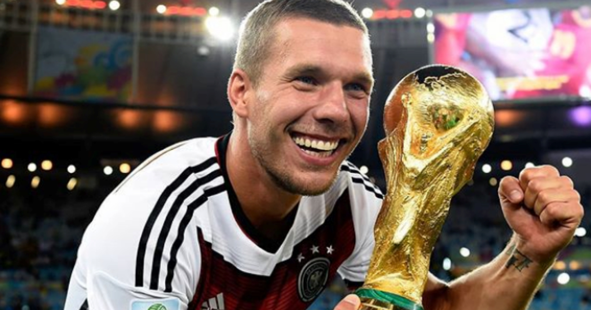 German soccer player holding the World Cup trophy