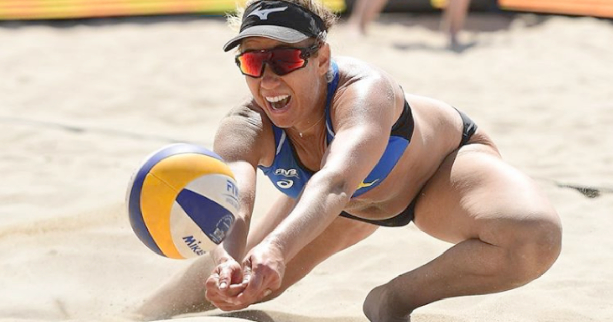 Woman playing beach volleyball for the AVP