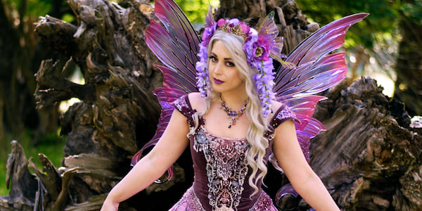 A fairy curtsying., science & tech, pop culture