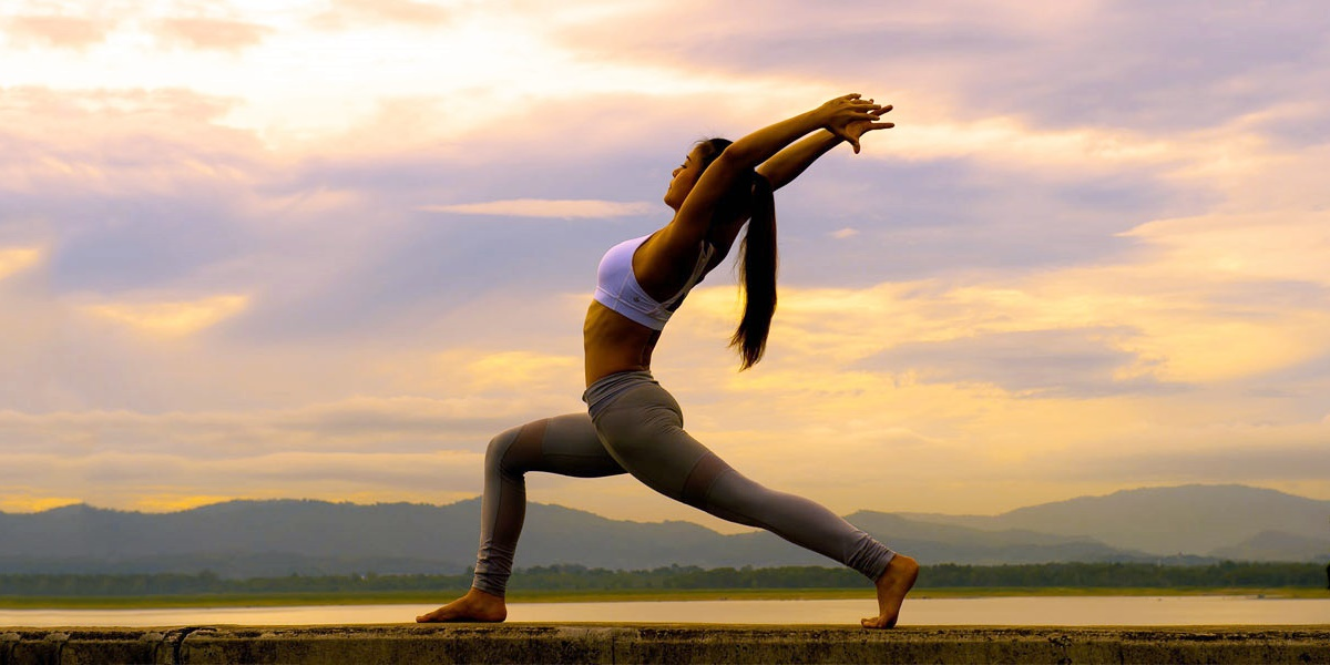 Woman doing yoga outside., science & tech, fitness