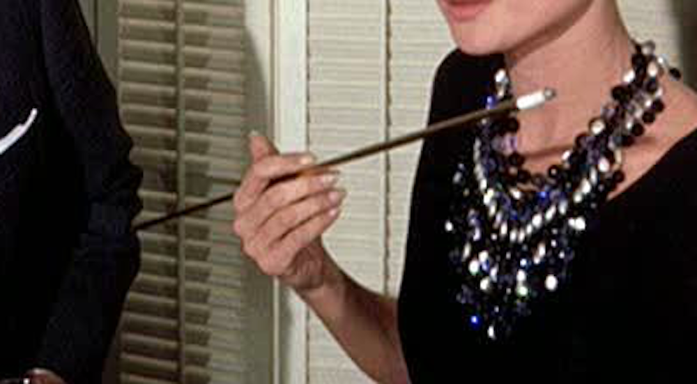 movies, breakfast at tiffany's, holly's cigarette holder