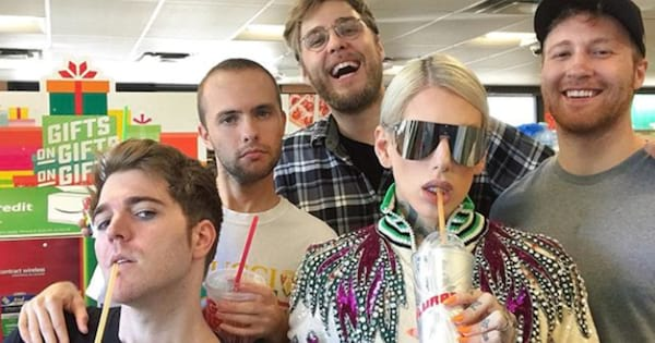 Shane Dawson and his friends posing with slurpees at a 7/11