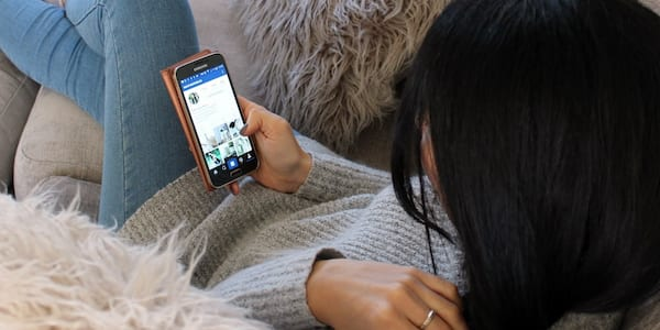 Woman using Instagram on phone., science & tech