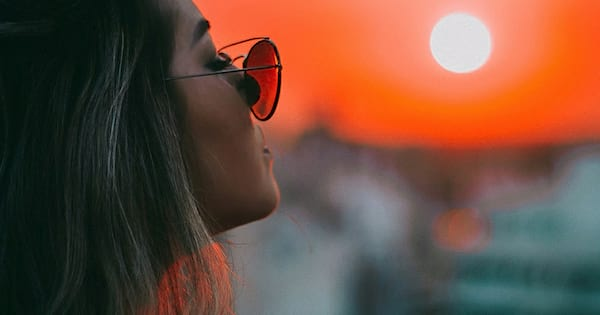 sunset, instagram captions, best, girl with sunglasses closing her eyes watching sunset