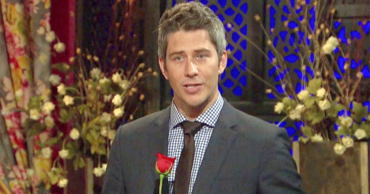 Ari on Season 21 of The Bachelor holding a rose during the Rose Ceremony