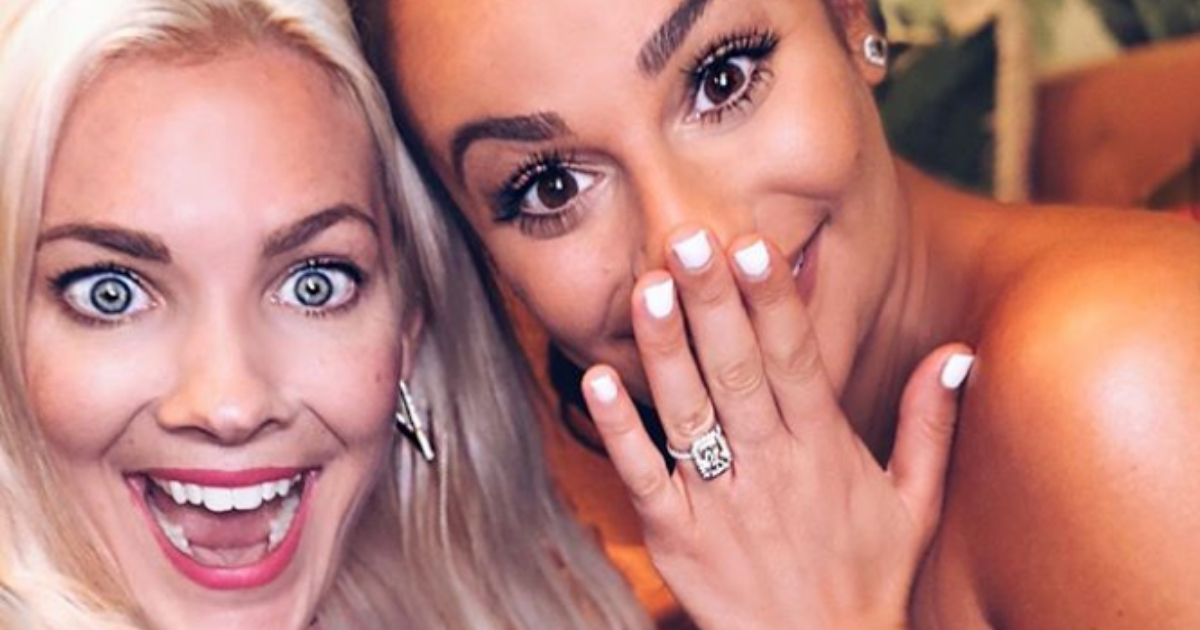 Lea Michele showing off her engagement ring with a selfie with her friend