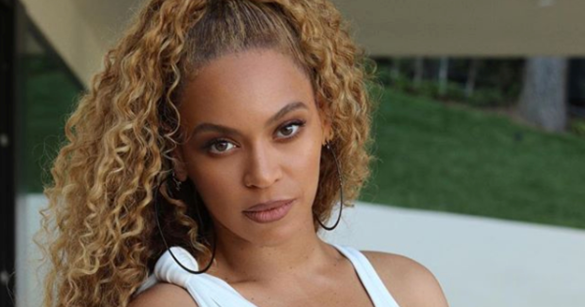Beyoncé wearing all white and striking a sassy pose for an Instagram picture