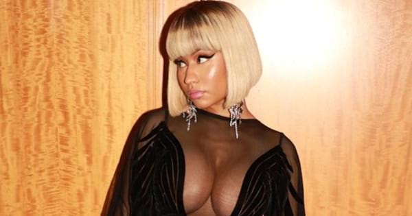 Nicki Minaj in an all black outfit looking to the side in an Instagram photo