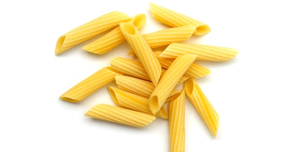Penne pasta shells on a white background