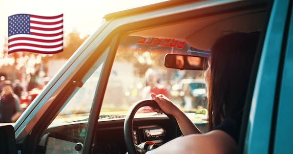 girl driving a truck to a country music festival
