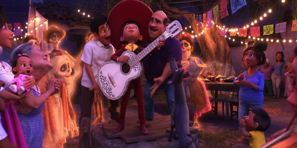 Coco - Miguel stands on a table next to his family and sings, movies