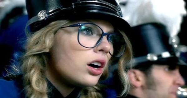 Taylor Swift dressed in a blue marching band uniform in her \You Belong With Me\ music video, blonde girl, glasses, ., band