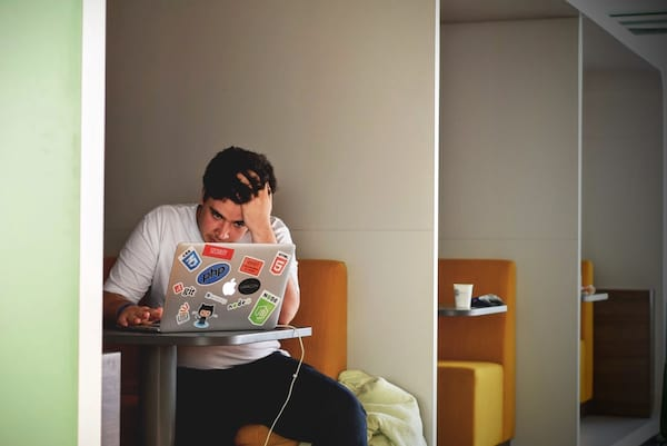 stock images of people working, reading, or typing on their laptop, unsplash
