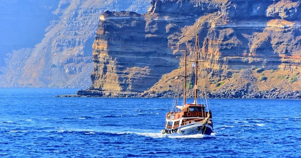 Off the coast of Santorini, Greece. A ship is visible with cliffs in the background., science & tech, travel