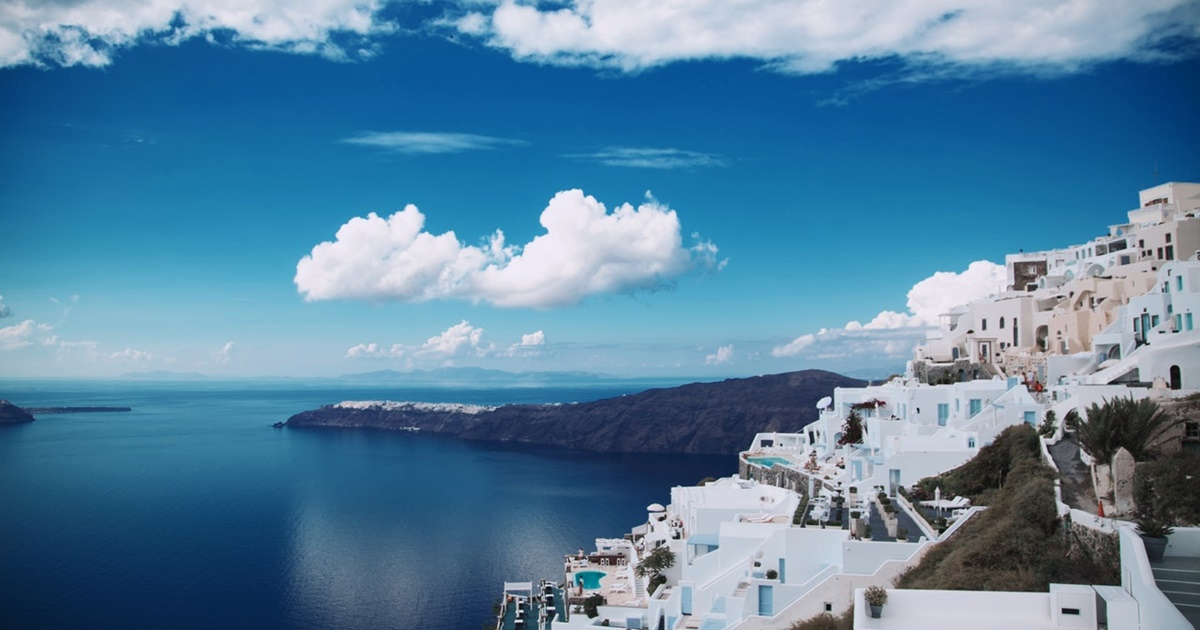 santorini, Greece during the day. The ocean is still and day is bright., science & tech, travel
