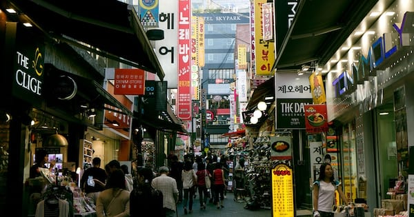 The Namdaemun Market during the daytime. It is busy with people shopping everywhere., science & tech, travel