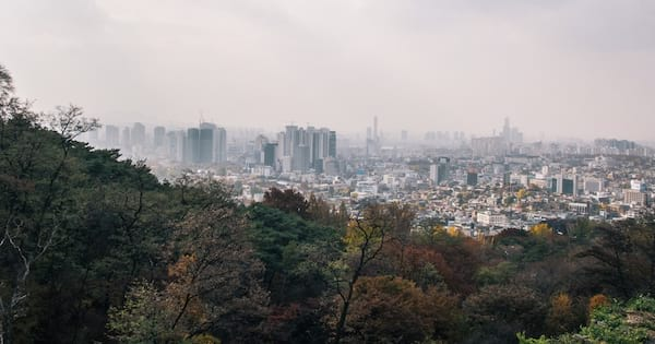 Seoul from a distance. A forest is in the foreground, obscuring some of the view., science & tech, travel