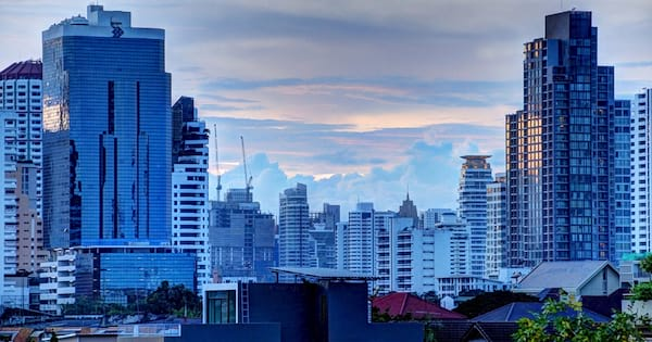 Downtown Bangkok. Clouds are in the distance, while rooftops are in the foreground., science & tech, travel