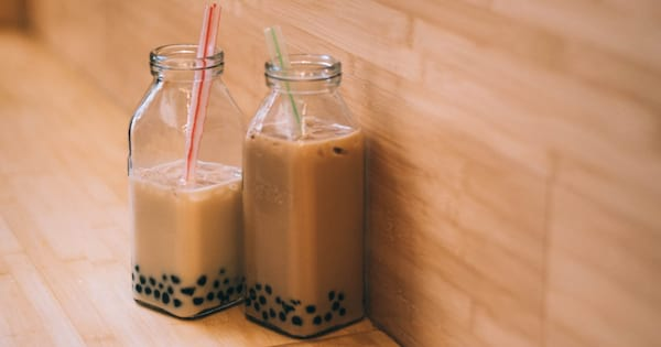 Two glass cups full of bubble tea