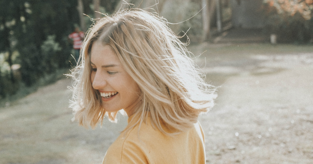 Girl smiling while twirling in the sunshine