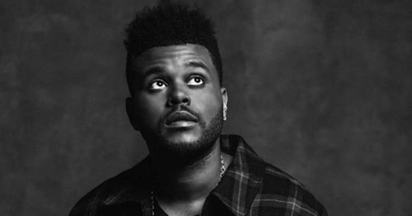 Black and white portrait of The Weeknd after his haircut
