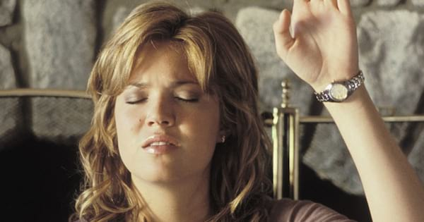 Mandy Moore holding her hand up while praying in Saved! (2004), religious, .