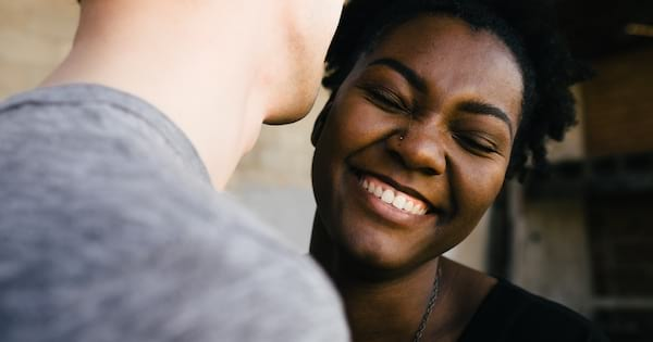 Girl smiling while boy is talking to her