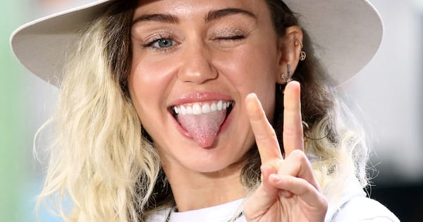 miley cyrus, instagram, captions, quotes, lyrics, miley cyrus winky face during concert with hat on short hair