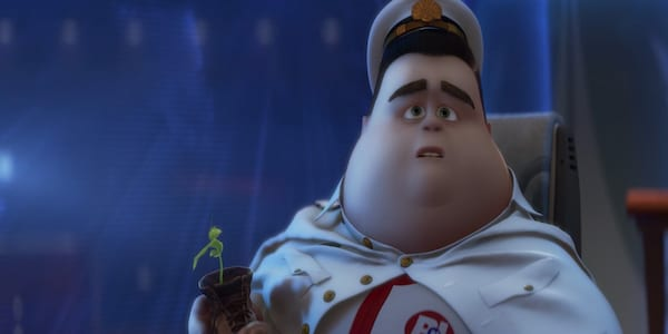 Captain B McCrea from Pixar WALLE holds a plant, movies