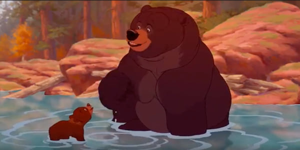 Koda from Disney's \Brother Bear\ swims in the river with a larger bear, movies