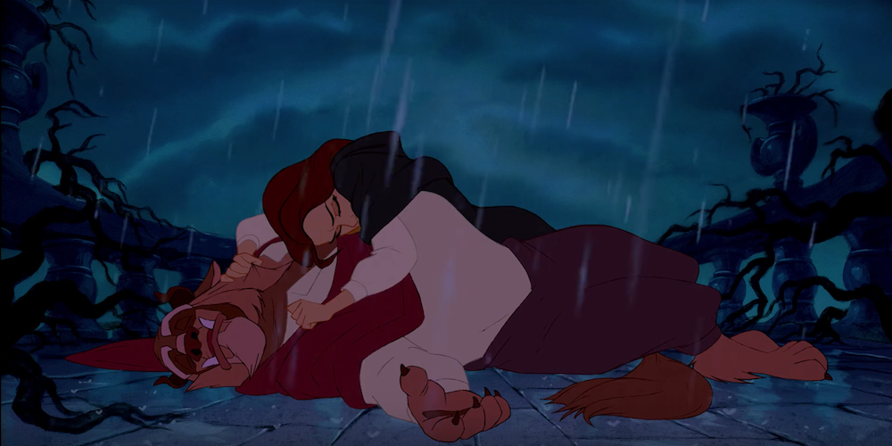 Belle from Disney's \Beauty and The Beast\ holds Beast in the rain as he transforms, movies