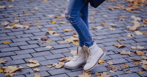 Woman showing off her boots in the fall
