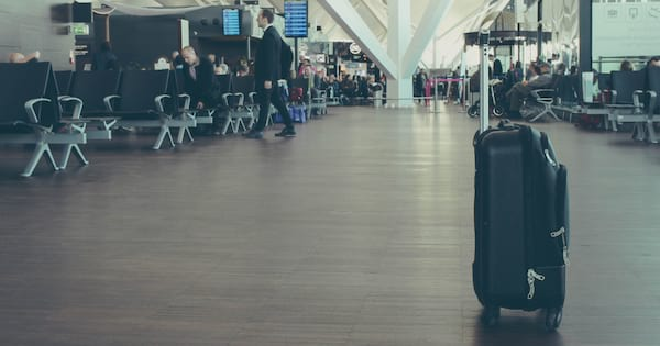 Bag with wheels in the middle of an airport