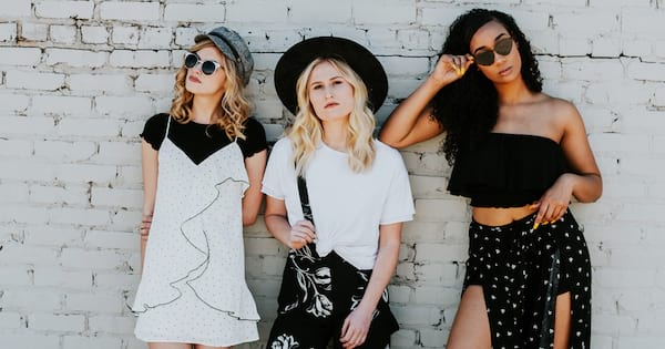 Three women wear various black and white stylish outfits., science & tech, fashion