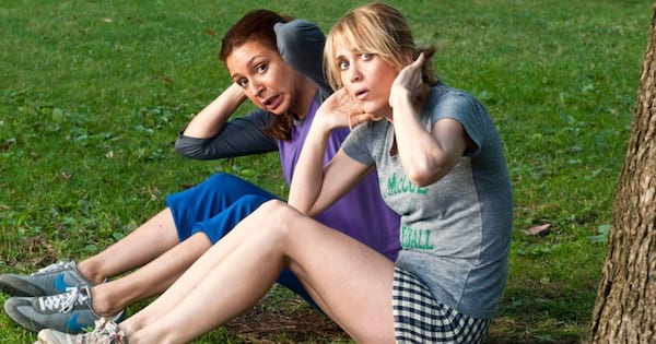 Kristen Wiig as Annie Walker and Maya Rudolph as Lillian Donovan working out in the park in Bridesmaids (2011)