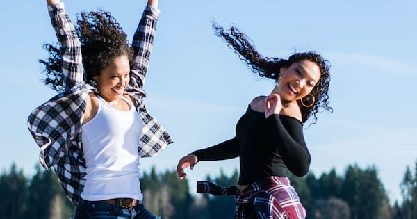Two women jumping in the air., science & tech, school
