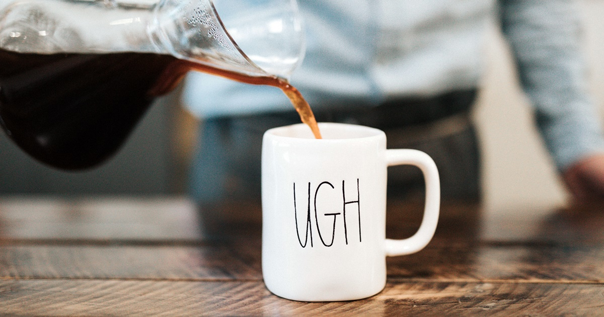 A coffee cup that says \ugh\ with coffee being poured into it., science & tech