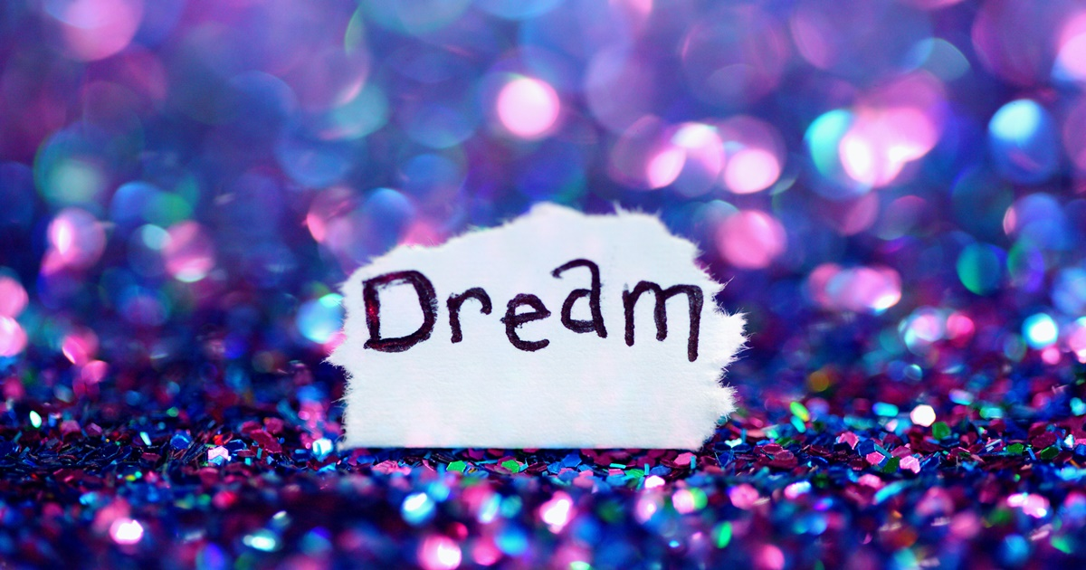 \Dream\ written on a scrap of paper on top of a sparkly background., science & tech