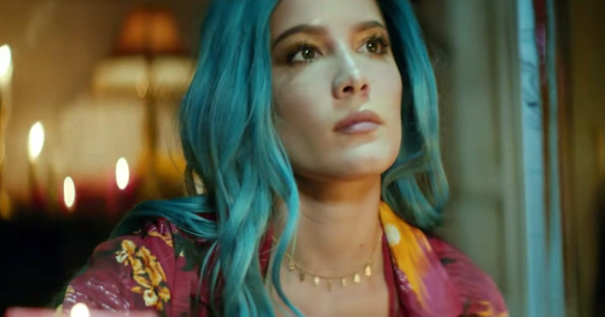 Closeup of Halsey looking off camera. She has long blue wavy hair, a mauve floral shirt, and gold necklace., science & tech, pop culture, Music, celebs