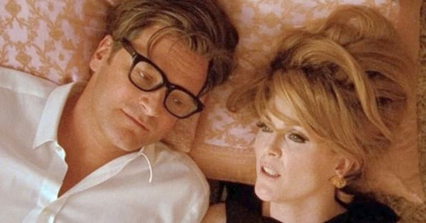 Colin Firth as George Falconer and Julianne Moore as Charlotte laying in bed together in A Single Man (2009)