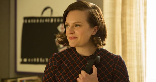 Peggy Olson talking on the phone in an episode of Mad Men