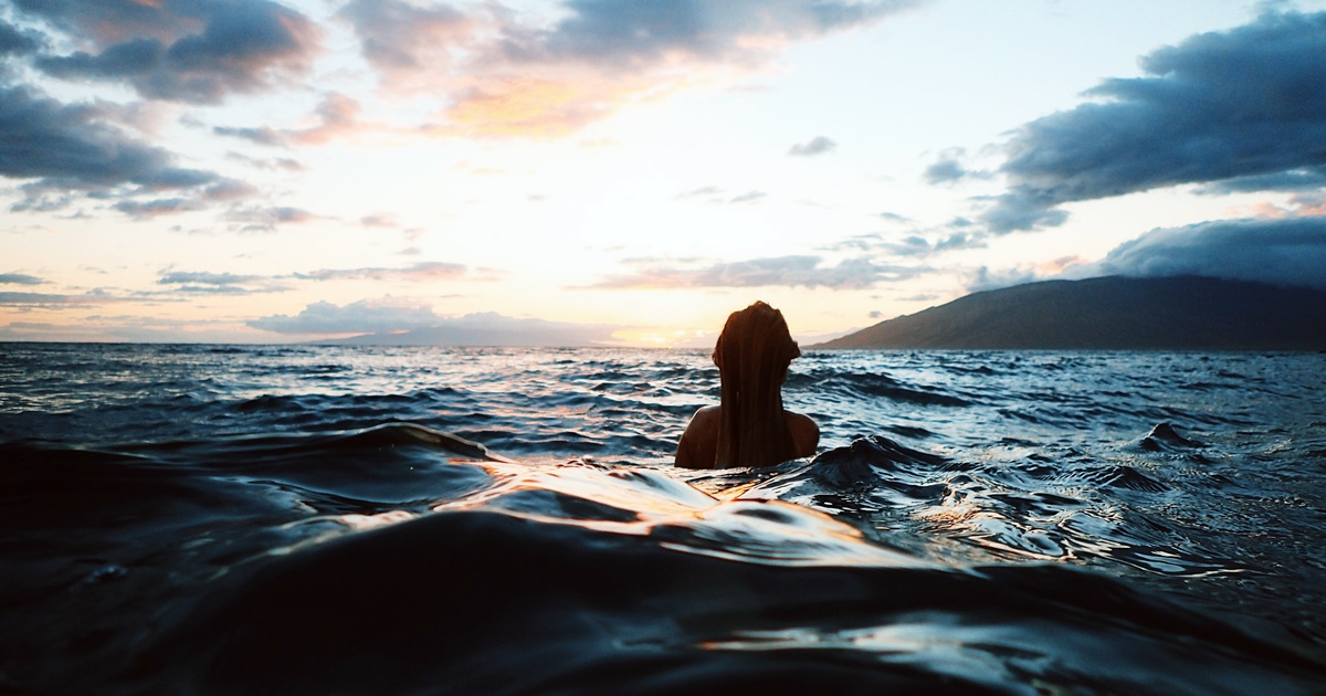 Woman swimming in the Ocean near Maui, Hawaii., science & tech, travel