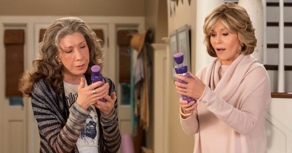 Grace and Frankie holding their vibrators on an episode of Netflix's Grace and Frankie