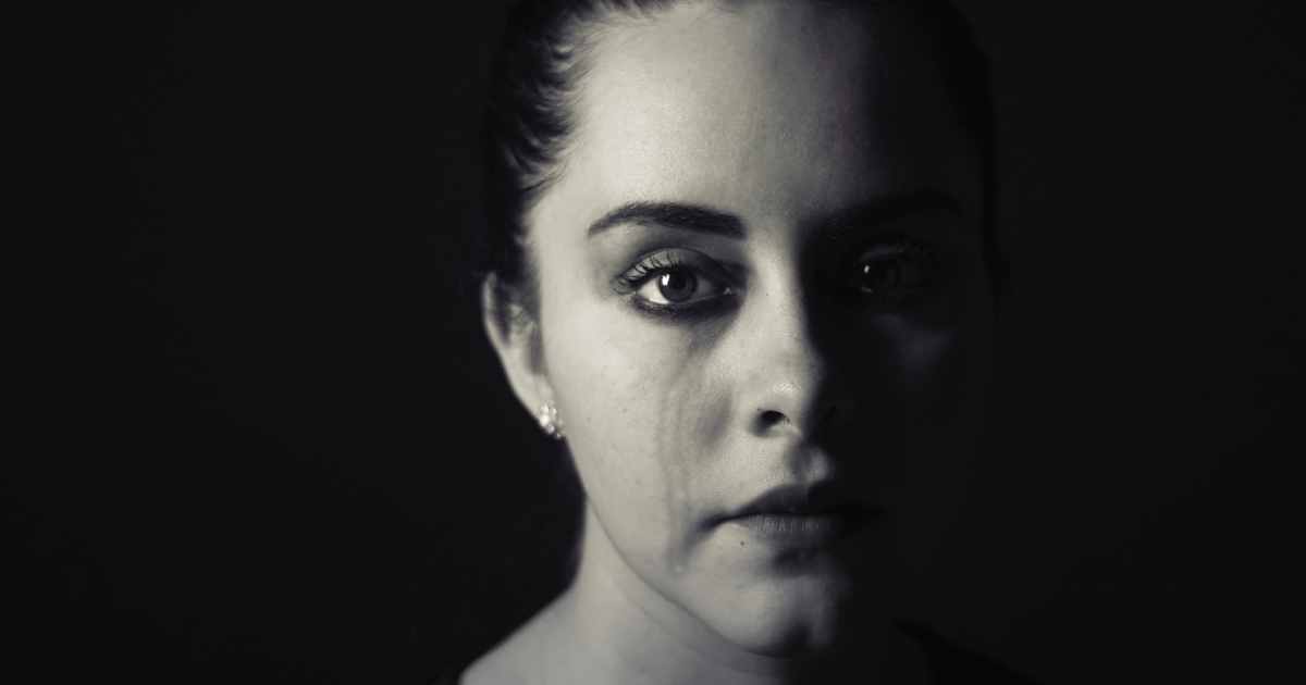 Black and white portrait of a woman crying