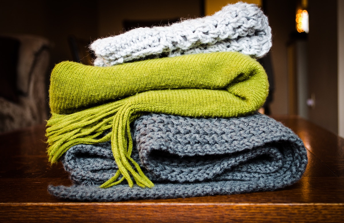 three scarves folded on top of each other