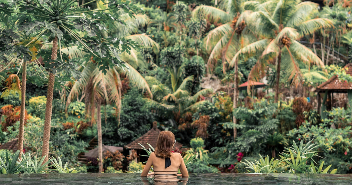A woman soaking in a pool in Bali, Indonesia., science & tech, travel