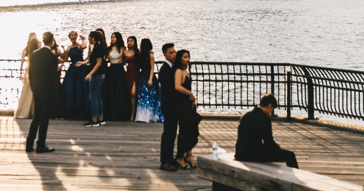 A group of kids getting pictures taken for homecoming., science & tech, school