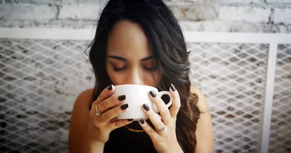 A woman drinking from a coffee cup., science & tech, health
