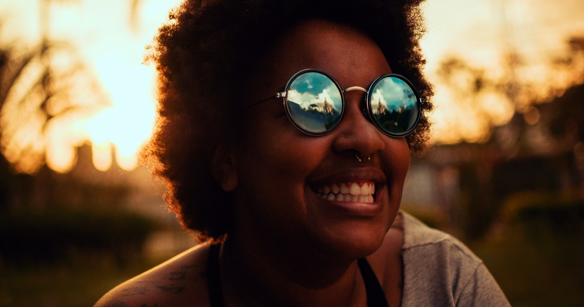 Woman smiling while at Afropunk., science & tech, Music